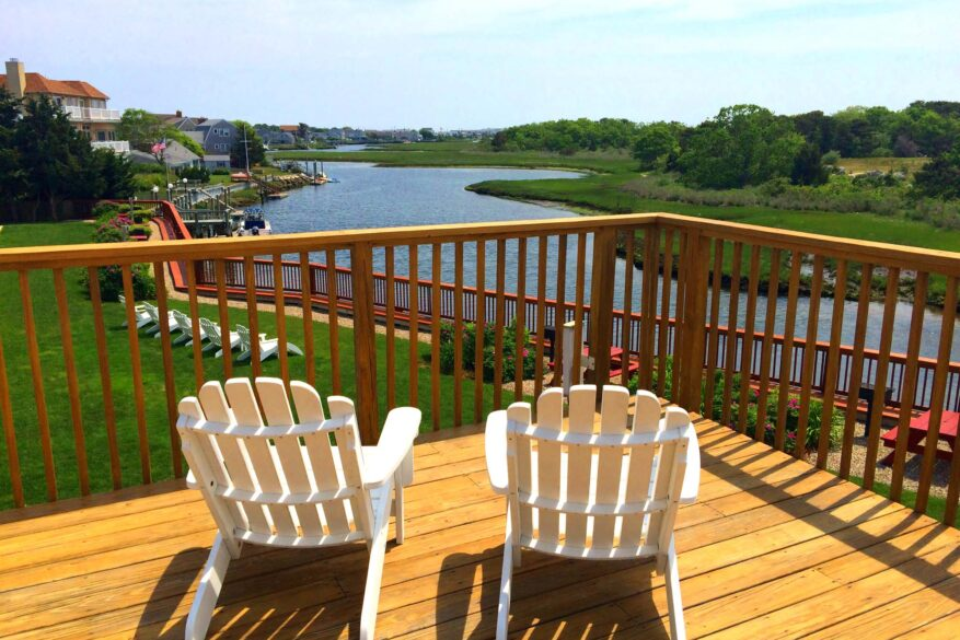Chairs on deck facing the back river