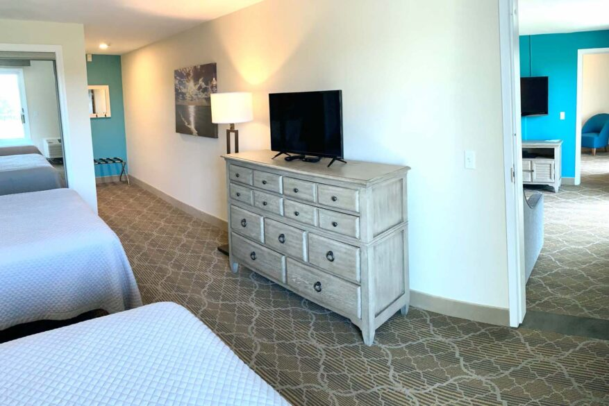 Guest Bedroom with two full-size beds and TV